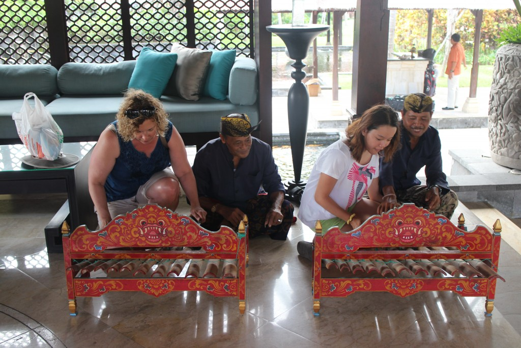 Marianne and Seraphine try out some gamelan music-making in the Nirwana resort in Tanah Lot.